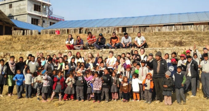 SIS students with school children in Nepal
