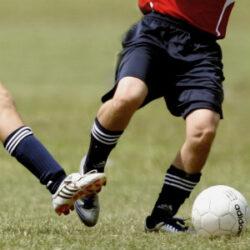 Feet trying to kick football