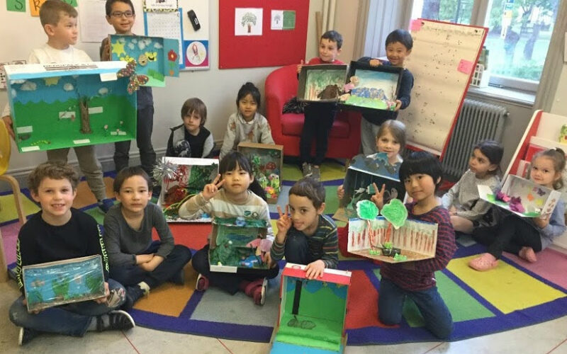 Kindergarten children with their dioramas