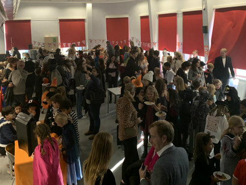 Parents and pupils socialising at the 2019 Halloween event