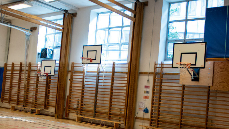 Basketball hoops in SIS sports hall