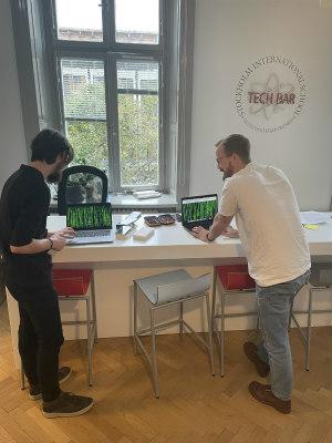 The Tech Bar team working on laptops